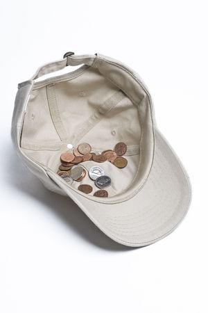 nickle: baseball cap with some canadian change in it