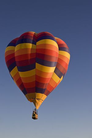 bumpy: Early morning lift off a multi-coloured hot air ballon Stock Photo