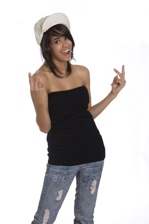tube top: Teenager girl pulling in tube top, jeans and knitted hat doing peace sign Stock Photo