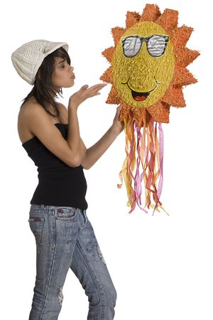 tube top: Teenage girl wearing a black tube top, knitted hat and jeans with holes holding a sunny pinata
