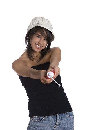tube top: Teenage girl wearing a black tube top, knitted hat and jeans with holes squeezing a ketchup bottle Stock Photo