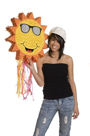 Teenage girl wearing a black tube top, knitted hat and jeans with holes holding a sunny pinata with great big smiles Stock Photo - 6164465