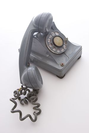 earpiece: dirty vintage gray unhooked rotary phone with crack casing and expose wired Stock Photo