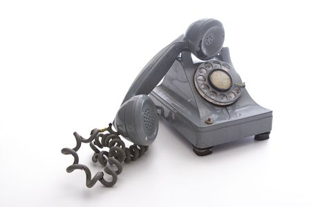 dirty vintage gray unhooked rotary phone with crack casing and expose wired Stock Photo - 6368210