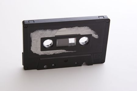 old tape cassette with cover sticker rip apart photo