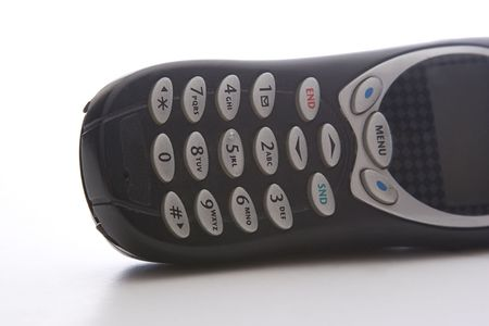 black cell phone lying on it's side, with a close up on the keypad Stock Photo - 6368304