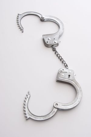 restraints: Open metal chained handcuffs