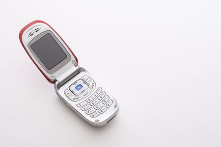 Red and silver cellular phone open with a blank screen