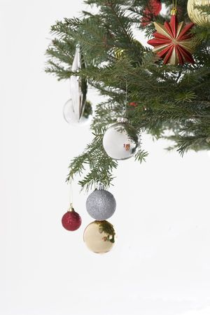 silver, red and gold christmas bulb hanging from the tree Stock Photo