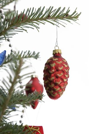 red christmas bulb in the shape of a pine cone hanging from the tree