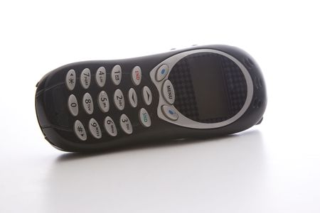 black cell phone lying on it's side Stock Photo - 6542460