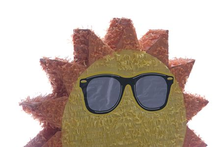 pinata: the rising of a big Pinata sun wearing sunglasses