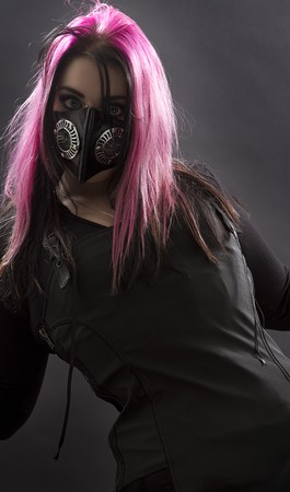 maniacal looking goth girl with pink hair and body piercing photo