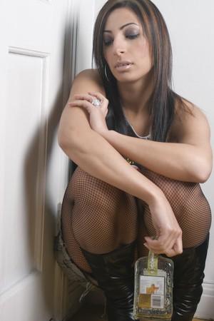 drunk woman: Twenty something model depress avec a drink Stock Photo