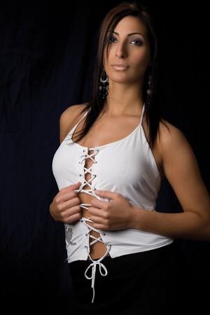 hottie: Twenty something fashion model pulling clothing  Stock Photo
