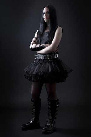 teen girl with black hair and goth style with frustrated expression wearing a black tutu photo