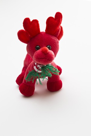 small red reindeer with red and white strip scraf photo