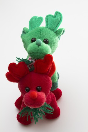 red and green toy reindeer standing one on top of the other Stock Photo - 7276070