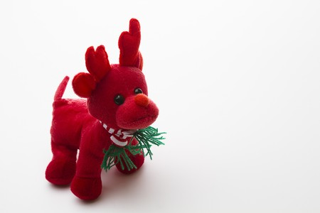 small red reindeer with red and white strip scraf