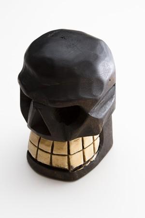 Mexican Dia de los muertos skull sculpture in wood photo