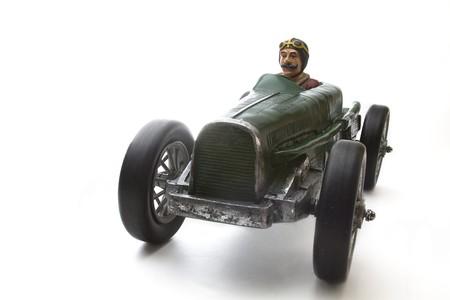 antieke speel goed race-auto met chauffeur snor  Stockfoto
