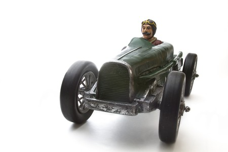 vintage toy race car with mustache driver