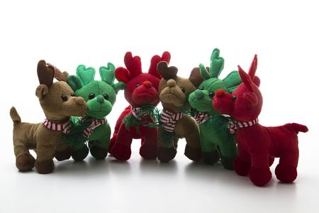 brown, green and red reindeer stuff toy, all close together for group shot Archivio Fotografico