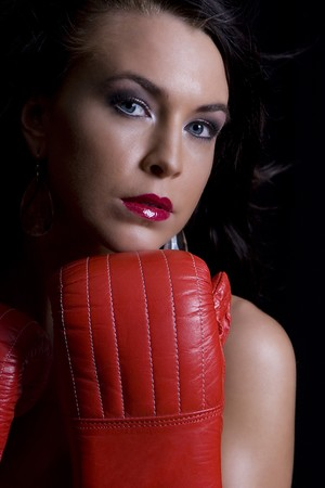 portrait of a young twenty something women hiding her body with boxing glove photo
