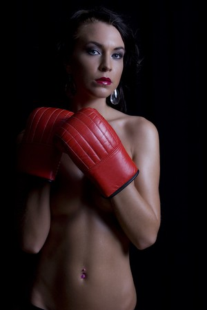young twenty something women hiding her body with red boxing glove