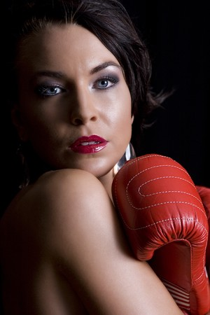 young twenty something women hiding her body with red boxing glove photo