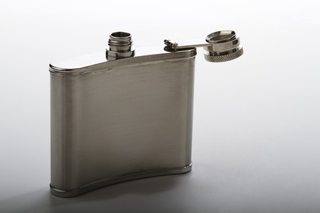 open flask against gray background Banco de Imagens