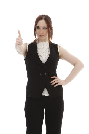 Young woman in business suit with thumbs up against a white background