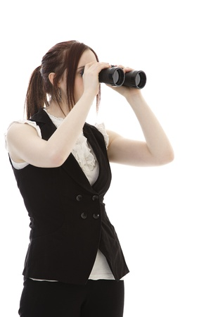 coporate: Young business woman with binoculars looking to the right Stock Photo