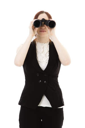 Young business woman looking throught binoculars against a white background