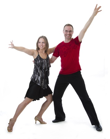Man and woman dancing salsa against a white background Stock Photo - 10519874