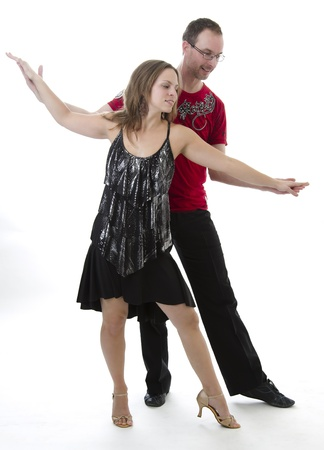 dancing club: couple dancing salsa in the middle of a pose