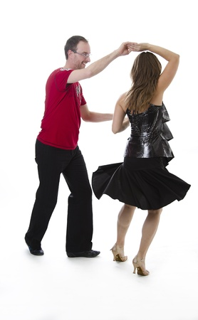 couple dancing salsa in the middle of a pose