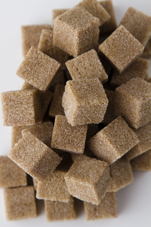 Pile of brown sugar cubes photo