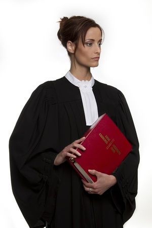 formal attire: Women dress as a canadian attorney, holding a red book of criminal law with bilingual text on it Stock Photo