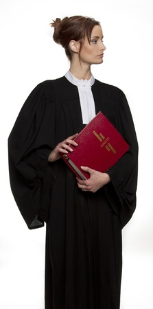 Women dress as a canadian attorney, holding a red book of criminal law with bilingual text on it Archivio Fotografico