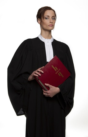 criminal law: Women dress as a canadian attorney, holding a red book of criminal law with bilingual text on it Stock Photo