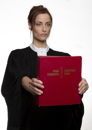 bilingual: Women dress as a canadian attorney, holding a red book of criminal law with bilingual text on it Stock Photo