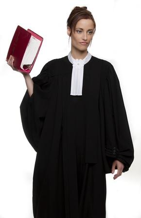 toga: Le donne vestono come un avvocato canadese, in possesso di un libro rosso del diritto Archivio Fotografico