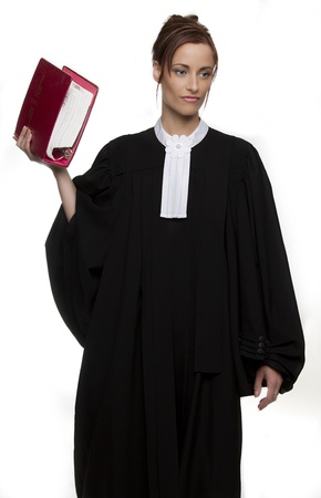 Women dress as a canadian attorney, holding a red book of law photo