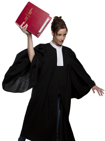 Women dress as a canadian attorney, throwing a red book of criminal law with bilingual text on it photo