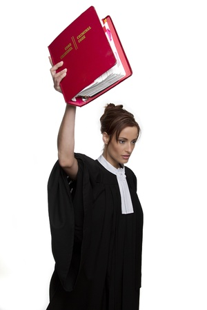 bilingual: Women dress as a canadian attorney, holding very high up, a red book of criminal law with bilingual text on it Stock Photo