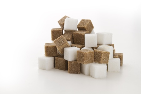 cubes of brown and white sugar stack in random fashion photo