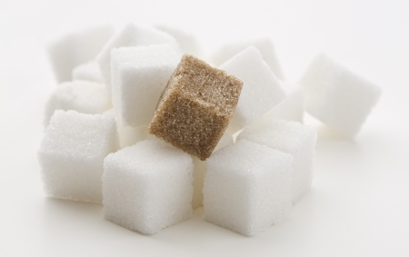 stack of white sugar cube with one brown cube photo