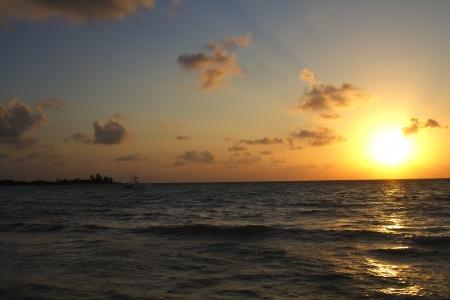 Sun rising over the ocean photo
