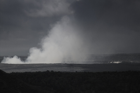 Steaming hole of the kilauea volcano during a cloudy day in black and white photo